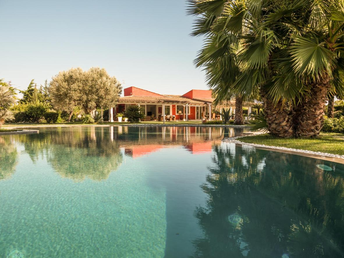 This Italian villa sits within a huge garden of palm, olive, fig, carob and lemon trees