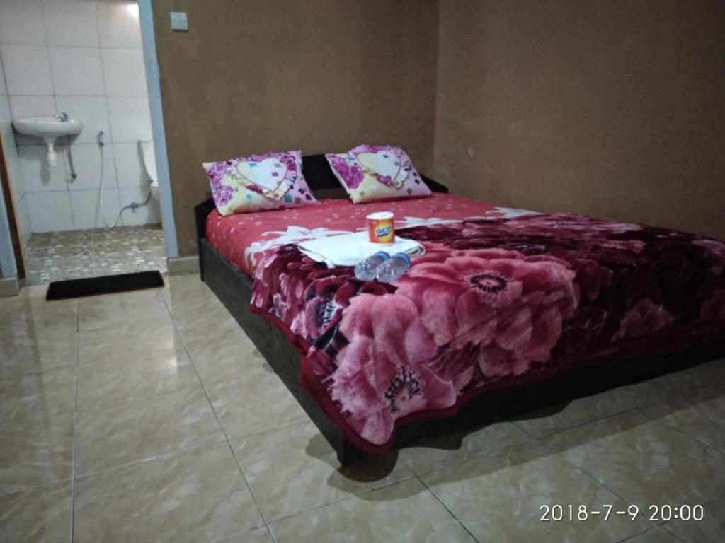 เตียงในห้องที่ Blue Mountain Cottage