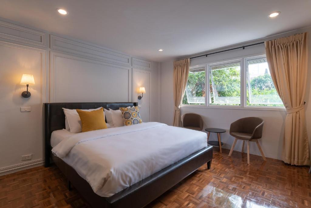 เตียงในห้องที่ The Mellow Pillow Hotel @ Chiang Mai Gate