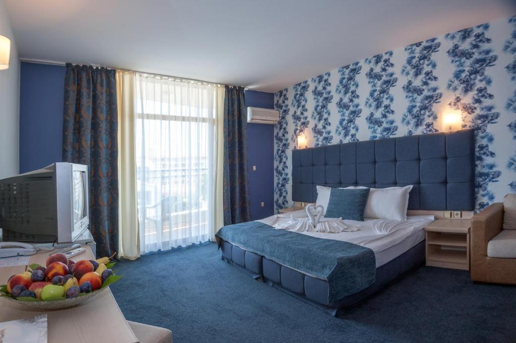 Кровать или кровати в номере Grenada Hotel - Все включено