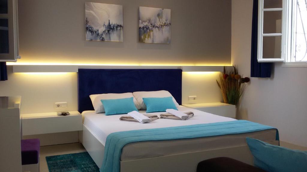 เตียงในห้องที่ Albatros Hotel