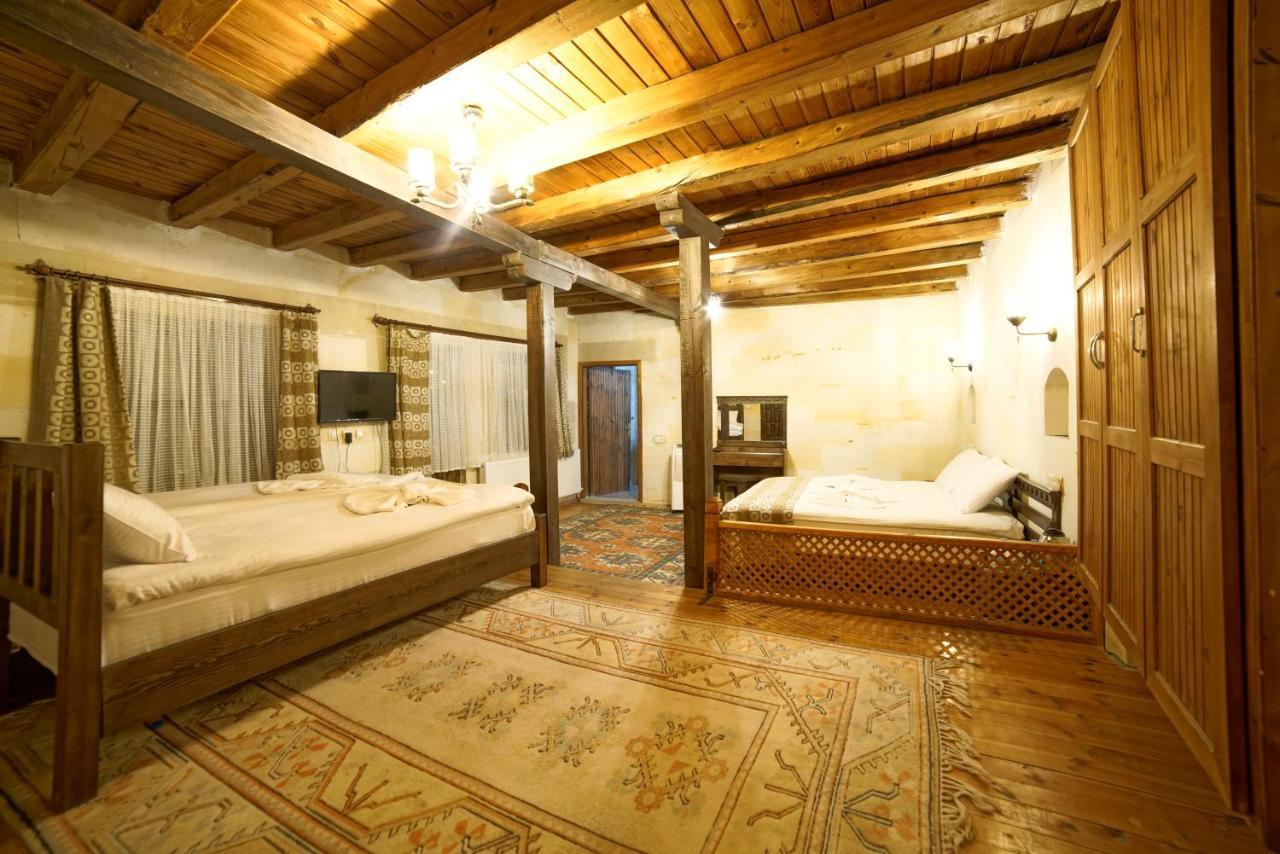 Letto o letti in una camera di Cappadocia Caves Hotel