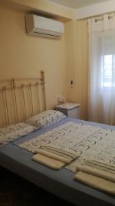 เตียงในห้องที่ Piso en Malvarrosa
