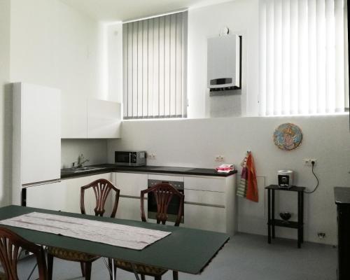 ครัวหรือมุมครัวของ Art Apartment Winterhafen