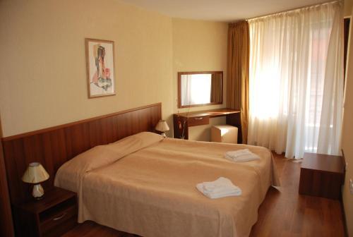 เตียงในห้องที่ Apart Hotel Comfort